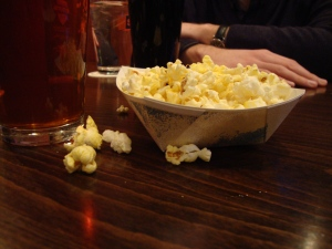 Post-class de-briefing with my colleagues. That beer is not mine. The popcorn, however...
