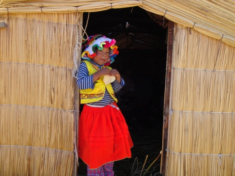 We saw some floating islands (the Uros Islands) on Lake Titicaca. They're made entirely of reeds. And this little imp lived on the one we visited. She was quite the charmer!