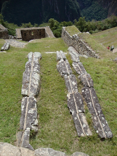These are aquaducts. Water still flows on Machu Picchu.