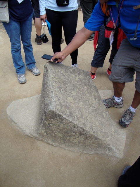 Compass Rock, Machu Picchu. Our guide is demonstrating (with his iPhone) that it is accurate.
