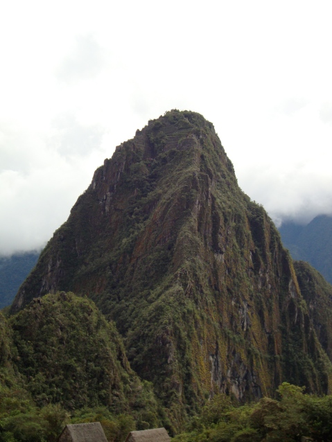 """Wayna (or Huayna) Picchu, which means """"New Peak."""" It's the peak in the background of most of the postcard shots of Machu Picchu and a steep climb away. Only 400 people are allowed on Wayna Picchu each day. You have to sign up in advance and then wait in line. We didn't, and although it would have been an amazing view, with its narrow trail and steep climb (people have fallen off) I'm glad we didn't."""