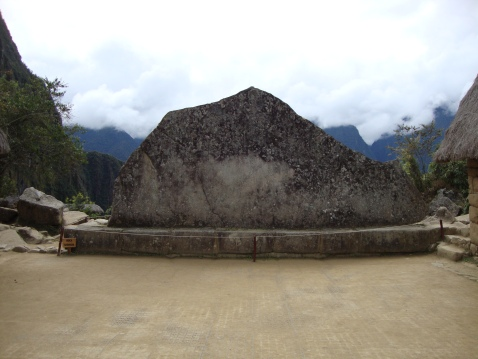 If the clouds weren't in the background, you'd see that this rock was carved to match the mountains behind it exactly.