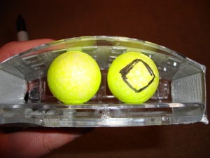 I colored two small balls with a highlighter, then drew on eyes. The socket is a soap dish I got at Menards.