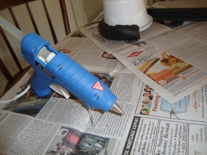 The offending glue gun. It's high heat, so it's supposed to glue better. It burns better, too...