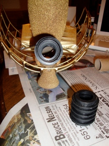 Gluing the rings and the hockey cage backing on. Apologies to those of you who play hockey. But it was for a good cause.