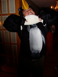 My friend Danny. It's hard to tell, but he's wearing a penguin shirt under a pretty sweet penguin costume.