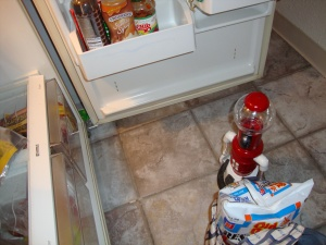 It's hard to put away groceries that are bigger than you are. Good thing chips don't go in the fridge.